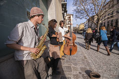 Street musicians in the career of the Darro, Granada, Spain Royalty Free Stock Photography