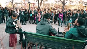 Street musicians celebrating Canakkale Victory and Martyr's Day in the street. Eskisehir, Turkey - March 18, 2017: Street musicians playing the song Bella Ciao stock video