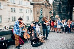 Street musicians on Charles Bridge. Street musicians in Prague on Charles Bridge Royalty Free Stock Images
