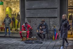 Street musicians on a city street. Italy, Naples, 03,01,2018 Street musicians on a city street stock photo