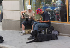 Street musicians. Conversation sketch about street musicians in the center of the city of Lviv Royalty Free Stock Images
