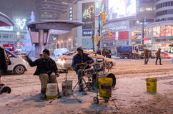 Street Musicians in  Downtown during a snowfall in Toronto Stock Photography