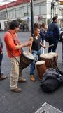 Street musicians and drums. Couple of young men playing big drums in a street corner to collect some money, mexican street, artist young male men in a corner of royalty free stock photos