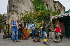 Street musicians entertain passers-by in Saint-Germain district. PARIS, FRANCE AUGUST 9, 2015 Street musicians entertain passers-by with a selection of royalty free stock photography