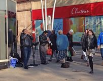 Street musicians or entertainers playing trumpets. Street musicians or entertainers playing trumpets to raise money. This is on the streets of Bedford, United royalty free stock photos