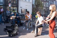 Street musicians gives performance. Utrecht, Netherlands - October 10, 2018: Four street musicians give performance on guitar royalty free stock image