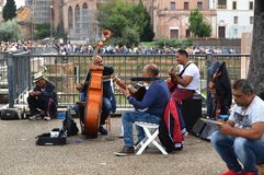Street musicians are happy to entertain tourists in the historical part of the city near the Roman forum, Rome, Italy. October 7, 2018 stock images