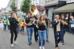 Street musicians in Haugesund, Norway, Europe. HAUGESUND, NORWAY – AUGUST 7, 2015: Swing band on the childrens parade as part of  the Jazz Festival Sildajazz Stock Image