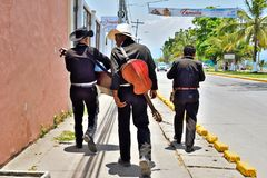 Street musicians. Honduras. Trio of street musicians in Puerto Cortes, Honduras, are heading towards the beaches in search of a living royalty free stock photos