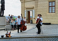 Street musicians at Hradcanske Square, Prague, Czech Republic Royalty Free Stock Photo