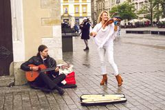 Street musicians in Krakow royalty free stock photo