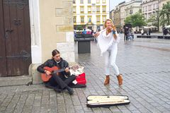 Street musicians in Krakow. Krakow, Poland - 27 October, 2017: beautiful concert of modern and classical music by street musicians, a man guitar player, and a stock photography
