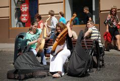 Street musicians. Lvov, Ukraine - July 22, 2016: Street musicians on Market Square, one of the most famous and busiest shopping square in Ukraine. Girls playing Stock Image