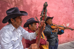 Street musicians in mexico. February 6, 2016 San Miguel de Allende, Mexico: local musicians performing on the street of the colonial tourist town for tips Stock Photography