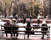 Street musicians. Mini-orchestra plays for vacationers in the park Stock Photos