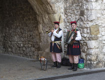 Street musicians in national costumes royalty free stock images