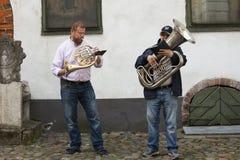 Street musicians in old Riga city, Latvia, Europe Royalty Free Stock Photo