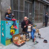 Street musicians on the one of the streets in the old downtown. Stock Images
