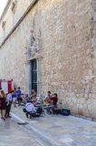 Street musicians perform on the main street of the Old City Stradun in the city of Dubrovnik, Croatia, Europe royalty free stock photo