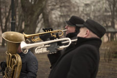 3 Street musicians plaing on public park. Jazz music in the big city. Royalty Free Stock Image