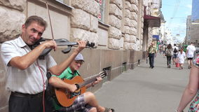 Street musicians play guitar stock footage