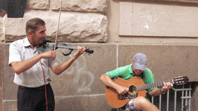 Street musicians play guitar stock video footage
