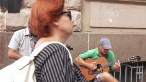 Street musicians play guitar stock video
