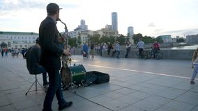 Street musicians play jazz on the town square. Musicians in the town square singing and playing.  Stock Image