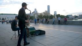 Street musicians play jazz on the town square. Musicians in the town square singing and playing.  Stock Photography