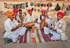 Street musicians play music on different traditional instruments Stock Images