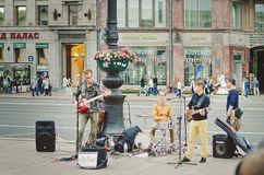 Street musicians play on the square in St. Petersburg. stock images
