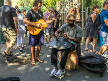 Street musicians play steel hand drum and guitar in Paris, France Stock Photo