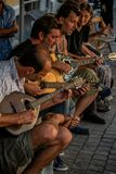 Street musicians play traditonal Greek instruments in Athens.
