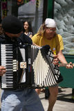 Street musicians playing accordion and guitar Royalty Free Stock Images