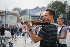 Street musicians playing classical music. SOPOT, POLAND - SEPTEMBER 10 2016: Amazing street musicians playing classical music on the streets of a seaside resort Royalty Free Stock Photo