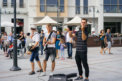 Street musicians playing classical music. SOPOT, POLAND - SEPTEMBER 10 2016: Amazing street musicians playing classical music on the streets of a seaside resort Royalty Free Stock Photos