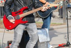 Street musicians playing on guitars. Unrecognizable persons stock photos