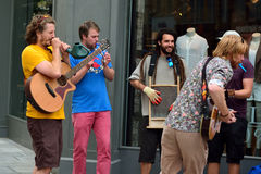 Street musicians playing odd instruments in Bath, UK royalty free stock image