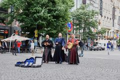 Street musicians playing on square of Prague. PRAGUE, CZECH REPUBLIC. Street musicians playing on square of Prague royalty free stock photo