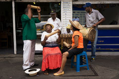 Street musicians playing in a street in the city of Cali, in Colombia Royalty Free Stock Image
