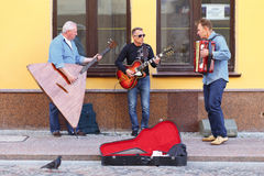 Street musicians playing on the street of Hrodna. HRODNA, BELARUS - JUNE 26, 2015: Street musicians playing on the street of Hrodna Royalty Free Stock Photography