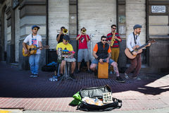 Street musicians playing in a street in the San Telmo neighborhood in the city of Buenos Aires Royalty Free Stock Photos