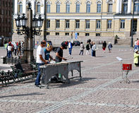 Street musicians are playing on the xylophone. HELSINKI, FINLAND - JULY 7, 2015: Street musicians are playing on the xylophone on the Senate Square in Helsinki Royalty Free Stock Photography