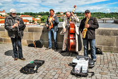 Street musicians in Prague on Charles Bridge Stock Images