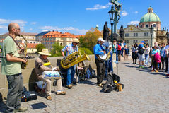 Street Musicians in Prague. Street musicians on Charles Bridge entertaining people stock photos