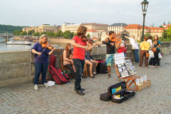 Street musicians. Prague, Czech Republic - 11, June, 2015.Street musicians on the bridge over the Vltava river to play the violin and cello Stock Photo