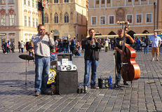 Street musicians in Prague`s Old Town Square Royalty Free Stock Images
