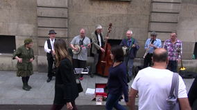 Street musicians seniors group  play before public in Paris Royalty Free Stock Photography