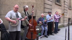 Street musicians seniors group  play before public in Paris Stock Photo