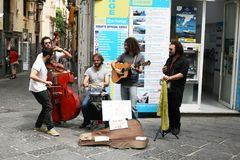 Street musicians in Sorrento side street. Musicians playing in the street in Sorrento Italy entertaining passers by stock photography